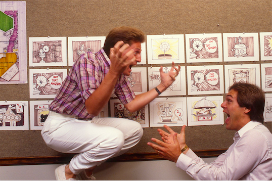 Ed Sotto attempts to convey his show concept for THE LABORATORY OF SCIENTIFIC WONDERS to Ted King and the two clearly have found some meeting of the minds. Copyright The Goddard Group All Rights Reserved
