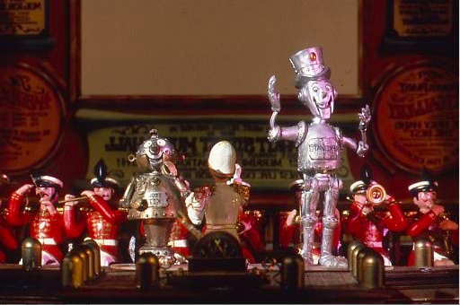 "The scale model with the ""Toy Band"" rising out of the orchestra pit and with the stars of the show MR. ELECTRO and PROTO at the edge of the stage. Copyright The Goddard Group"