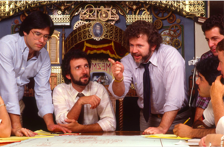 Story meeting at Landmark Entertainment with the massive model of the MAGIC LANTERN THEATRE behind key team leaders Gary Goddard and Tony Christopher, and Project Manager George Wade Copyright The Goddard Group  All Rights Reserved