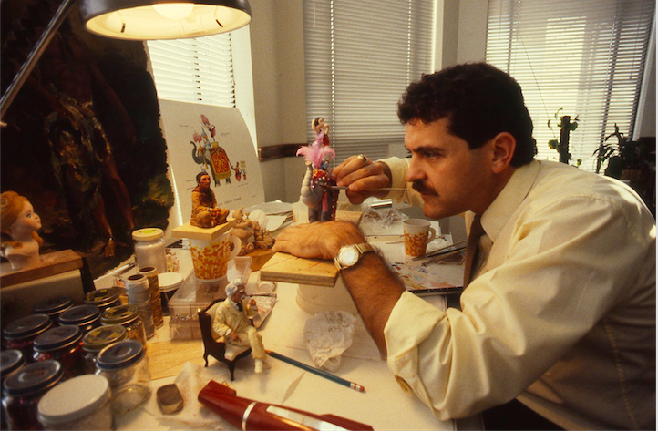 Joe DeMeis (Art Director) puts the finishing touches on one of the more than 80 animatronic characters in THE MAGIC LANTERN THEATRE.  The original Marc Davis artwork, with the character that is being detailed, can be seen in the background. Copyright The Goddard Group All Rights Reserved